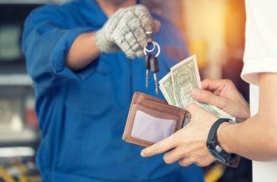 Auto repair shop business return keys to customer for profit