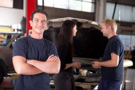 Auto repair shop business - mechanic with customers