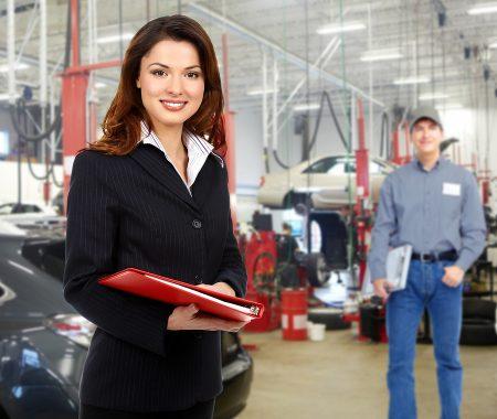 Female auto repair service advisor in shop